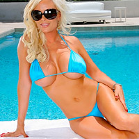 Diamond Foxxx busting out of blue bikini